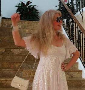 Adrienne Papp wearing A dress by Jessica Bazan